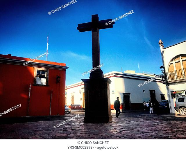 A cross decorates a street of Santiago de Queretaro, Mexico