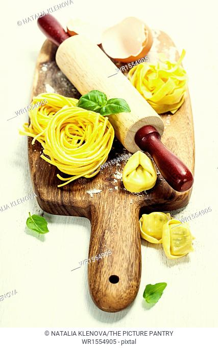 Making homemade pasta on wooden table