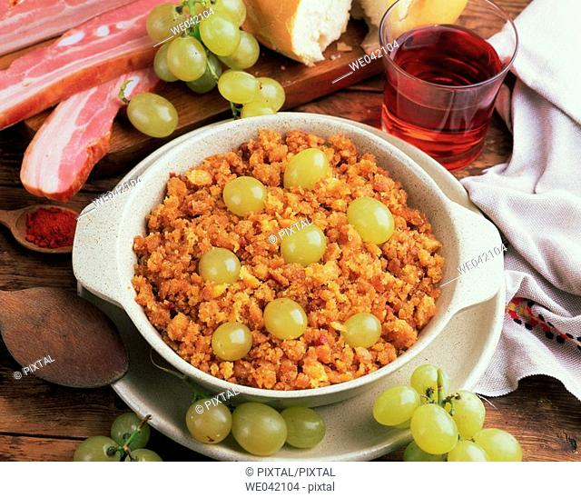 'Migas' (traditional dish in Spanish cuisine) with grapes