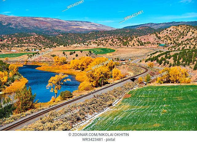 Landscape with autumn trees and river. Rocky Mountains, Colorado, USA