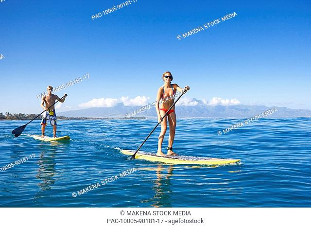 Hawaii, Maui, Paia, Paddle boarders in the ocean off Maui's north shore /nNO COMMERCIAL USE