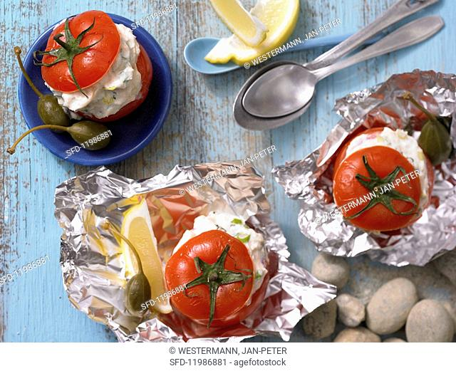 Tomatoes filled with ricotta and aerved with herbs and capers