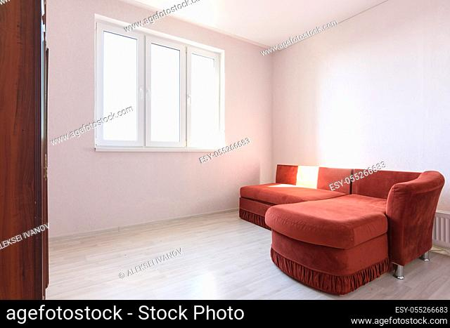 Interior of a bright room with an old sofa in the bedroom