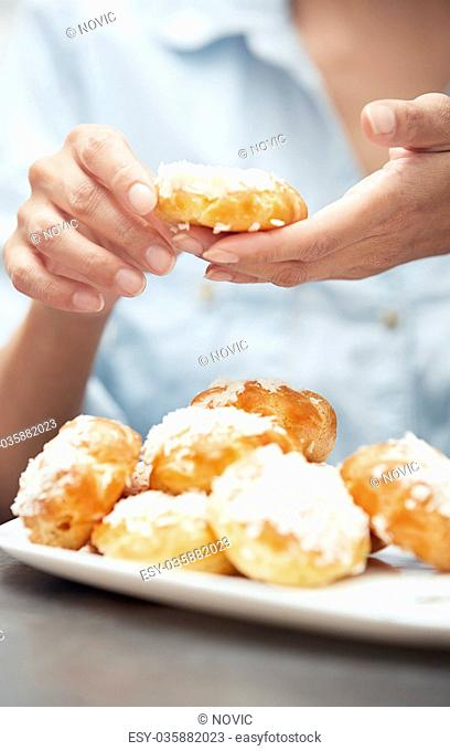 Woman preparing eclairs at home