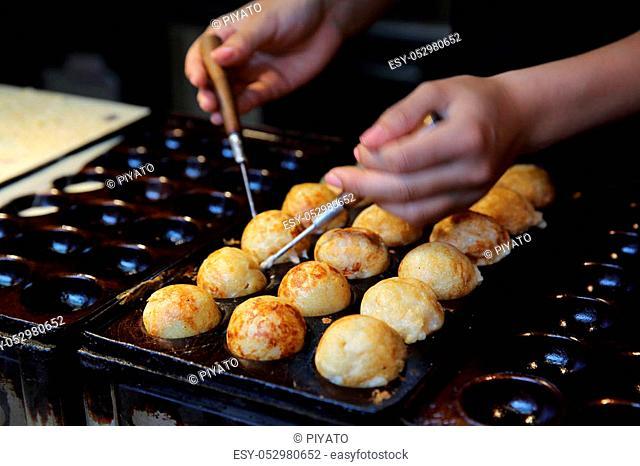 process to cooking takoyaki japanese food