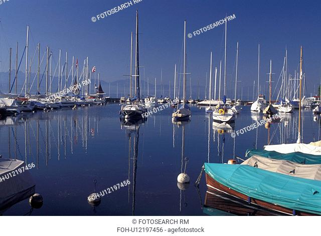 Switzerland, La Cote, Vaud, Lake Geneva, Boats docked in the harbor along the lakefront in the town of Morges on Lac Leman