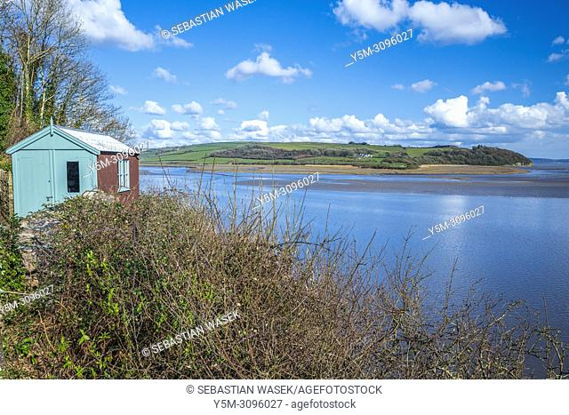 Dylan Thomas boathouse with Estuary River Taf at Laugharne, Carmarthenshire, Wales, United Kingdom, Europe