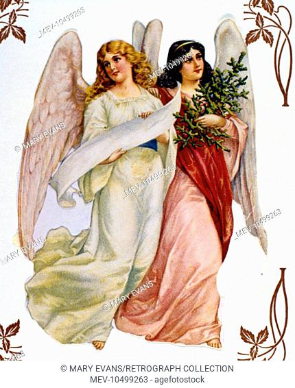 Two Christmas angels, one carrying a tree