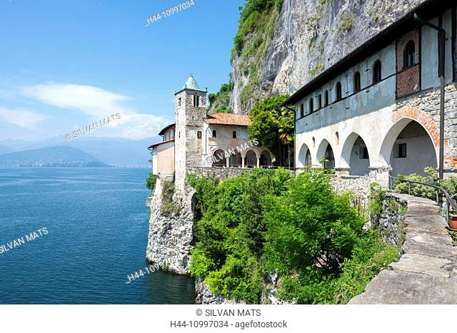 Eremo di santa caterina del sasso and lake Maggiore with mountain in a sunny day in Lombardy, Italy
