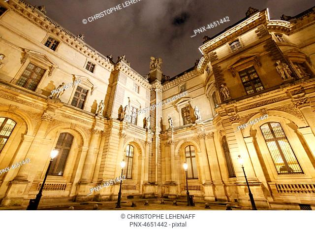 Paris. 1st district. Louvre Museum by night. Facades of pavilions Sully and Denon