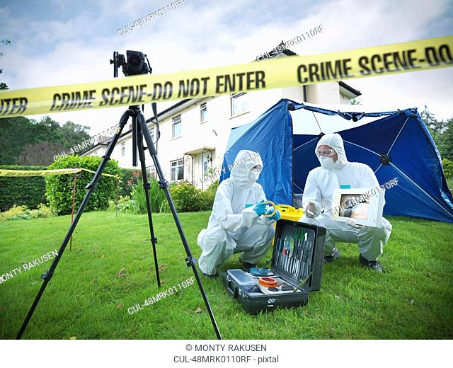 Forensic scientists at crime scene