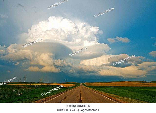 A rotating supercell storm forms over the road east of Broken Bow, Nebraska, USA