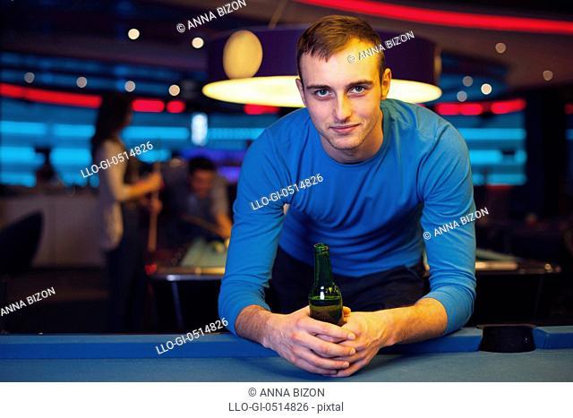 Portrait of handsome man in billiard club. Rzeszow, Poland