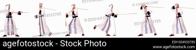 Arab man pulling rope in tug of war concept