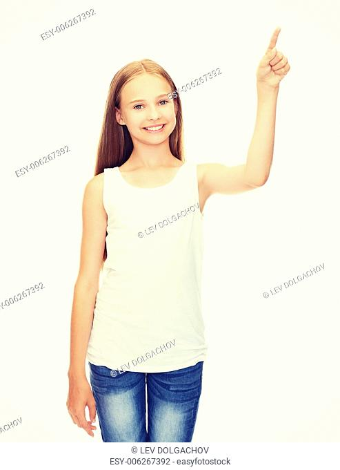 shirt design concept - smiling teenage girl in blank white shirt pointing to something or pressing imaginary button