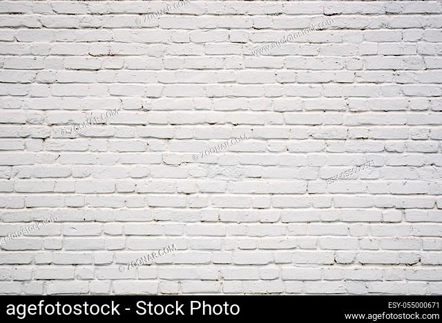 Background or backdrop of white chipped brick wall