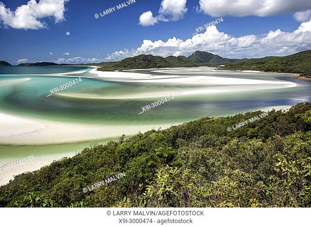 View from Hill Inlet of the waters, cove and swirling sands of Whitsunday Island with Windhaven Beach in the distance in Queensland, Australia