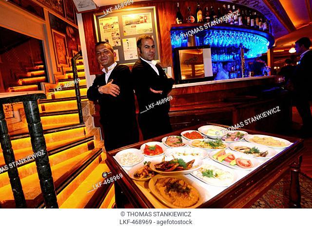 Waiters serving Meze in a hotel restaurant, Sultanahmet, Istanbul, Turkey