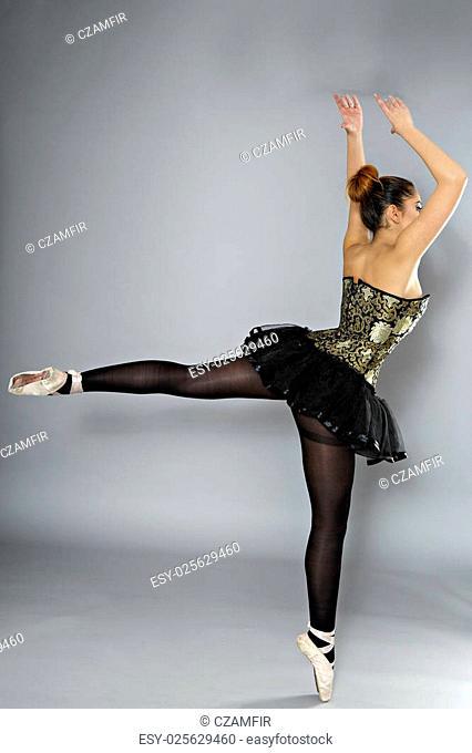 Professional female ballet dancer isolated in studio