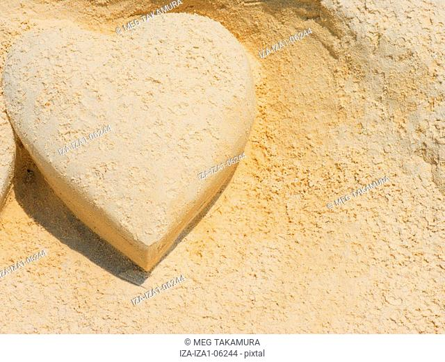 Close-up of a heart shape made by sand