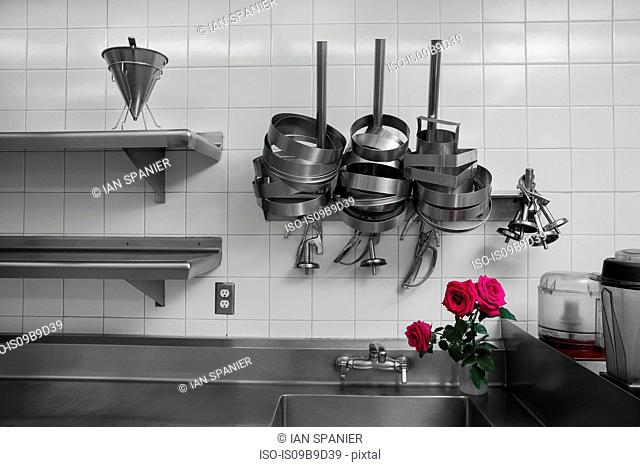 Cake tins on drying rack in commercial kitchen