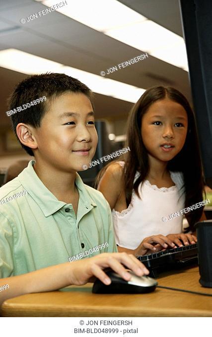 Asian students using school computer