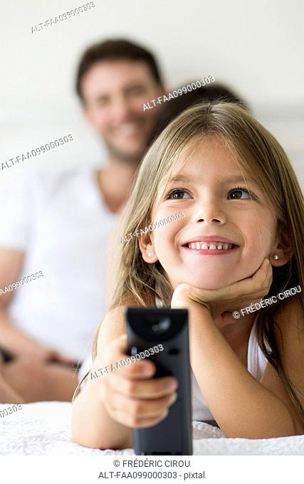Little girl holding remote control