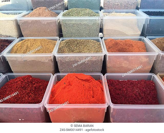 Different spices in plastic boxes at the street market of the Selcuk, Izmir, Aegean Coast, Turkey, Europe