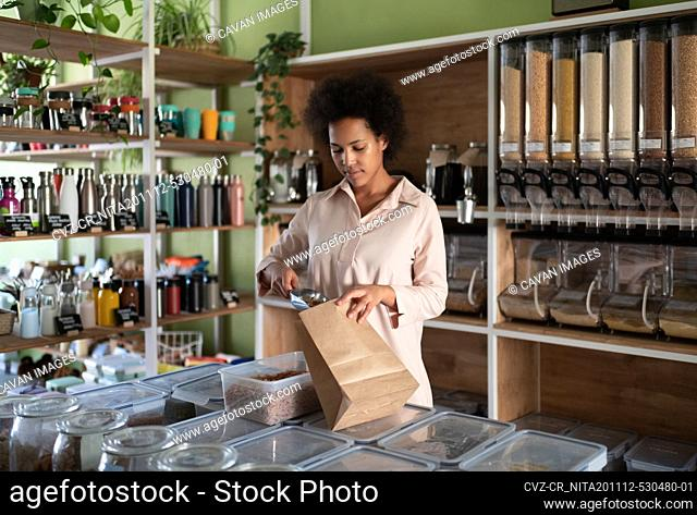 Black small business owner packing organic pasta