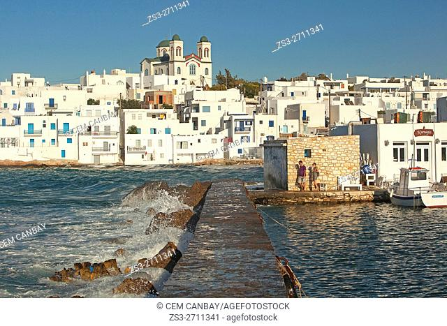 Waves at the pier with the main church at the background, Naoussa, Paros, Cyclades Islands, Greek Islands, Greece, Europe