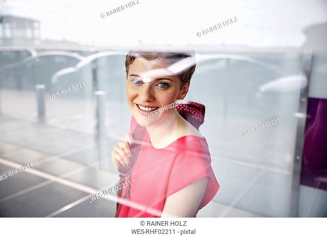 Portrait of smiling woman at the airport