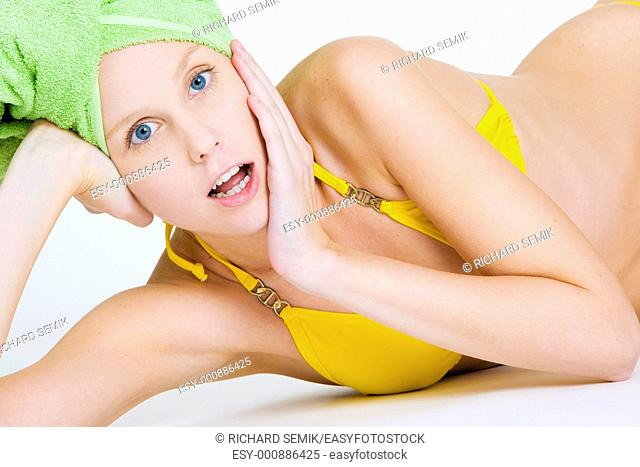 portrait of woman with towel on head
