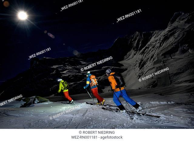 Austria, Men skiing in snow at Salzburger Land
