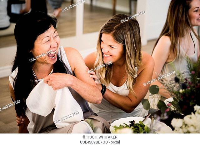 Women enjoying friendship and meal in yoga retreat