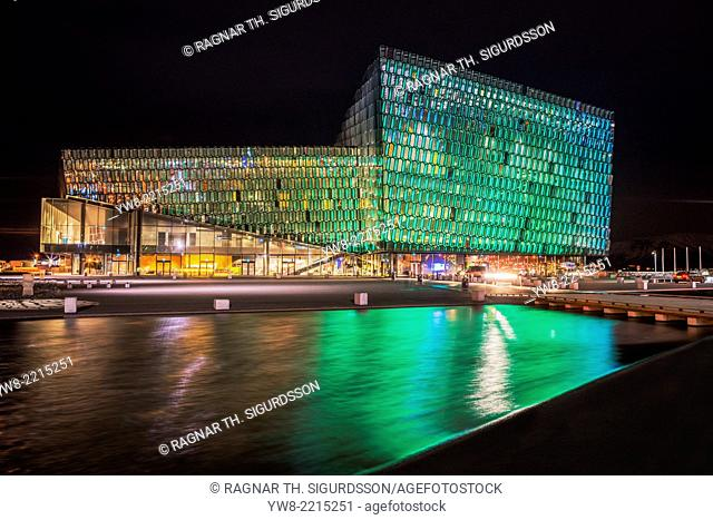 Harpa Concert Hall and Conference Center, Reykjavik, Iceland. Colorful lights are displayed during Reykjavik's Winter Lights festival