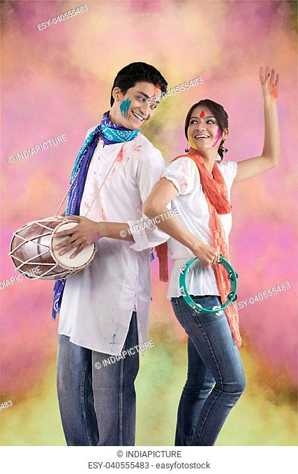 Couple enjoying Holi