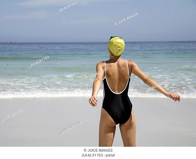 Rear view of woman at beach
