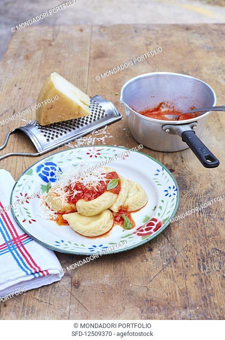 Culurgiones (Sardinian ravioli with tomato sauce, Italy)