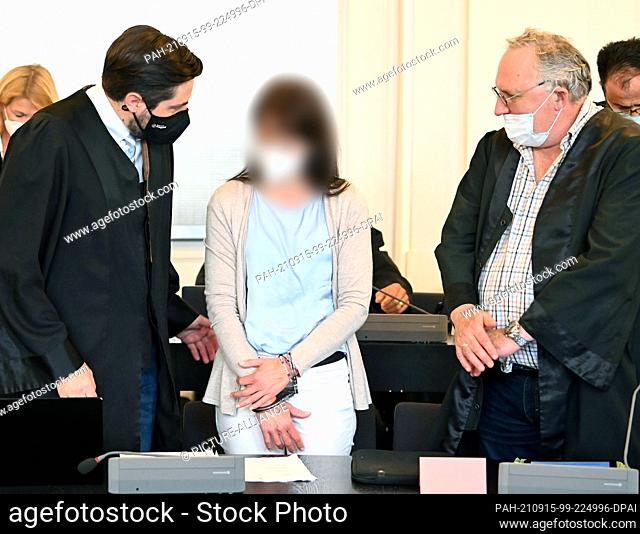 15 September 2021, Baden-Wuerttemberg, Karlsruhe: A 49-year-old defendant waits in the jury courtroom of the Karlsruhe Regional Court together with her lawyers...