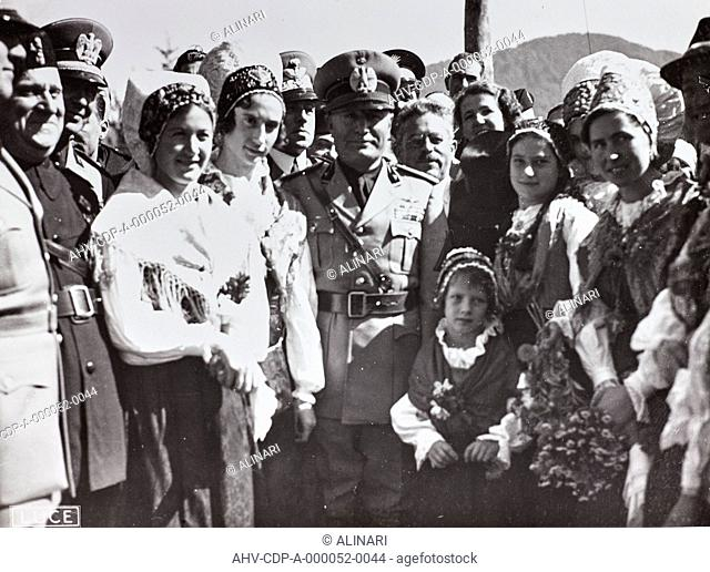 Album The Duce's trip to Trieste: Benito Mussolini (1883-1945) photographed with a group of women in traditional dress. During this trip the Duce proclaimed the...