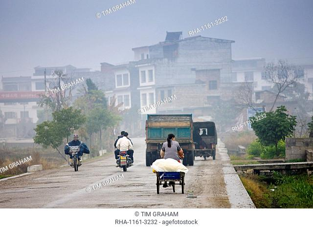People travelling on the road to Fuli, Xingping, China