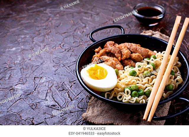 Ramen noodles with meat, vegetables and egg. Japanese food