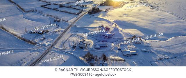 Panoramic top view of snow covered farm in Akureyri, Northern Iceland. This image is shot using a drone