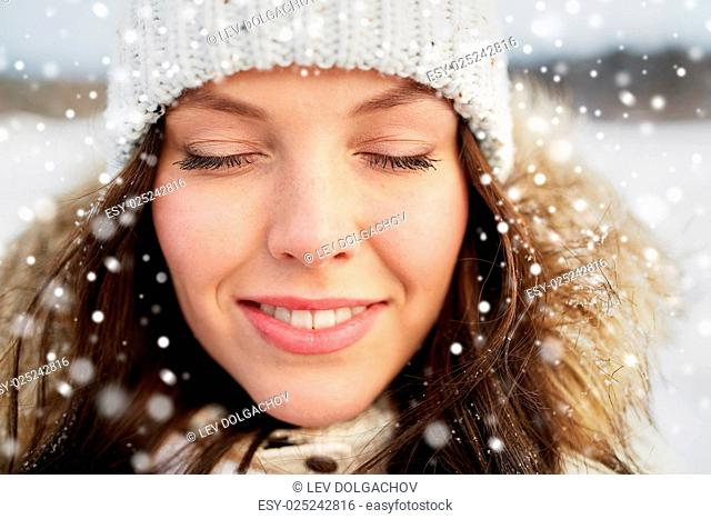 people, season and leisure concept - happy woman outdoors in winter