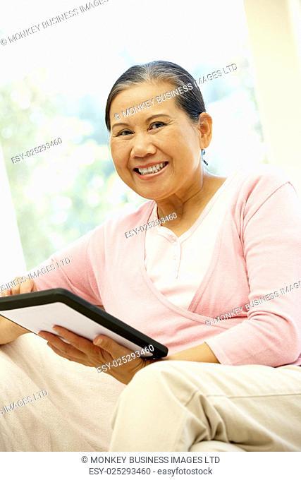 Senior Asian woman using tablet