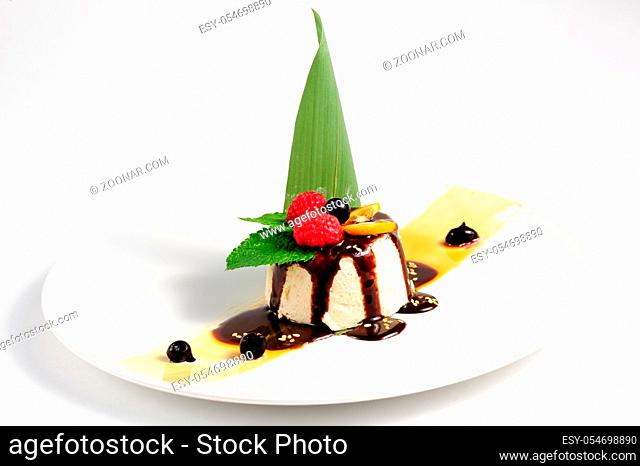 semifredo, italian ice cream dessert with halva, raspberry and chocolate sauce on top