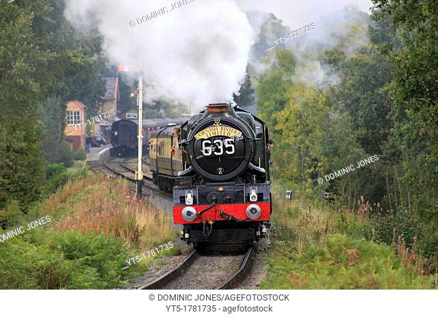 GWR 'King' 4-6-0 No 6024 King Edward the 1st powers out of Hampton Loade Station on the Severn Valley Railway, Shropshire, England, Europe