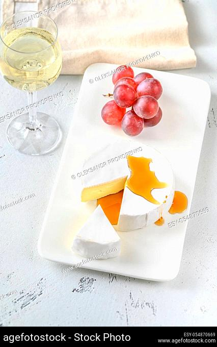 Camembert with glass of white wine