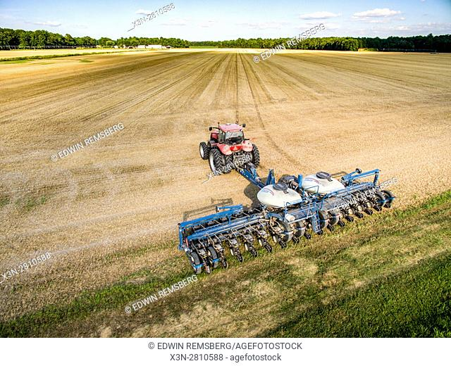 Aerial view of a planter moving through a field to double crop soy beans over wheat stubble