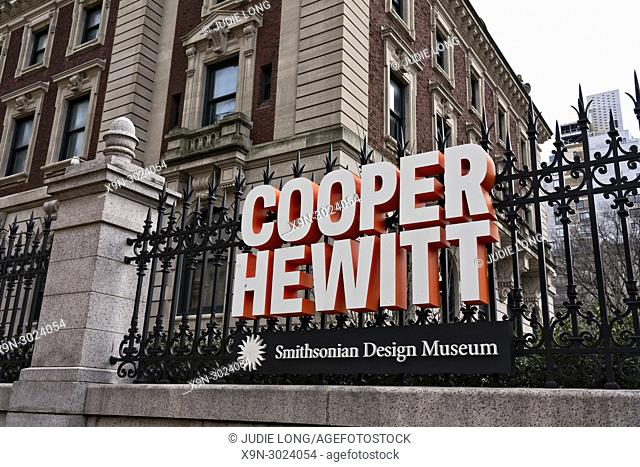 New York City, Manhattan. Looking up at the Cooper Hewitt Museum and the Sign on the Fence